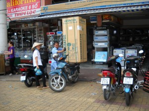 Loading refrigerator on motorbike